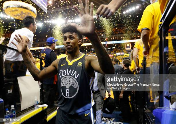 Golden State Warriors' Nick Young is congratulated by fans on the way to the locker room after beating the Cleveland Cavaliers 122103 in Game 2 of...