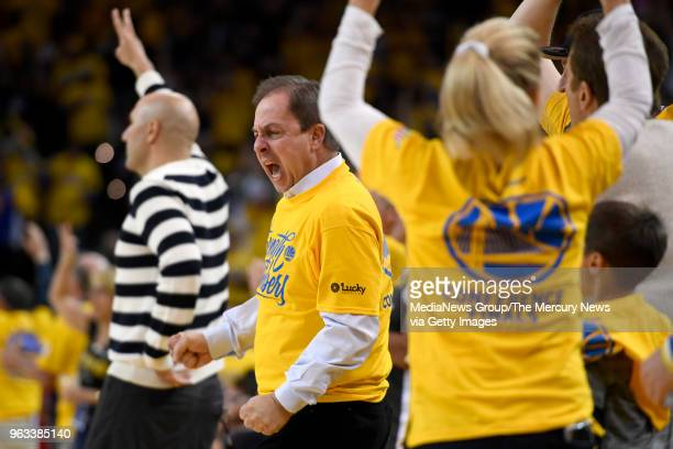 Golden State Warriors owner and CEO Joe Lacob celebrates during the third quarter in Game 6 of the NBA Western Conference finals against the Houston...