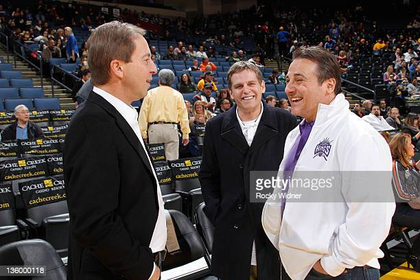 Golden State Warriors owner Joe Lacob and Sacramento Kings owners Joe Maloof and Gavin Maloof chat before a preseason game on December 17, 2011 at...