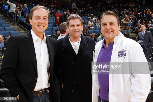 Golden State Warriors owner Joe Lacob and Sacramento Kings owners Joe Maloof and Gavin Maloof pose for the camera before a preseason game on December...