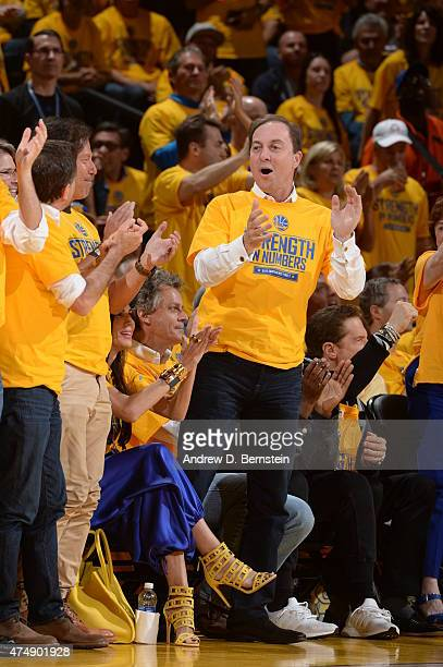 Golden State Warriors owner Joe Lacob cheers on his team against the Houston Rockets in Game Five of the Western Conference Finals during the 2015...