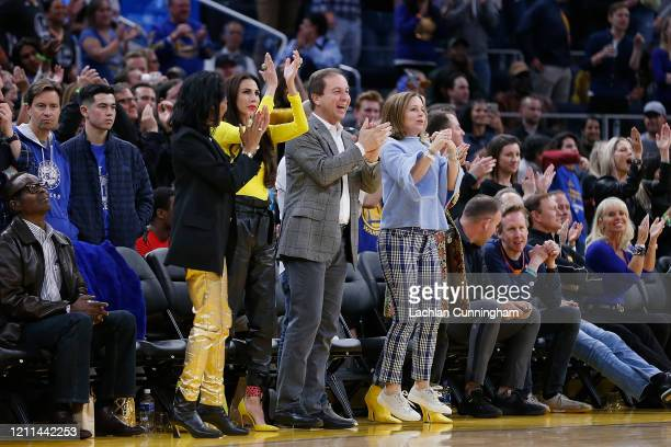 Golden State Warriors owner Joe Lacob supports the team with his wife Nicole Curran in the second half of the game against the Philadelphia 76ers at...