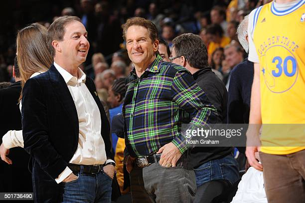 Golden State Warriors owners Peter Guber and Joe Lacob watch their team face the Phoenix Suns on December 16 2015 at Oracle Arena in Oakland...