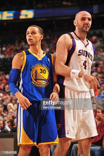 Golden State Warriors point guard Stephen Curry and Phoenix Suns center Marcin Gortat look on during the game March 18 2011 at US Airways Center in...