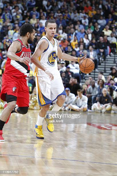 Golden State Warriors point guard Stephen Curry brings the ball up court during the game against the Portland Trail Blazers on April 13 2011 at...