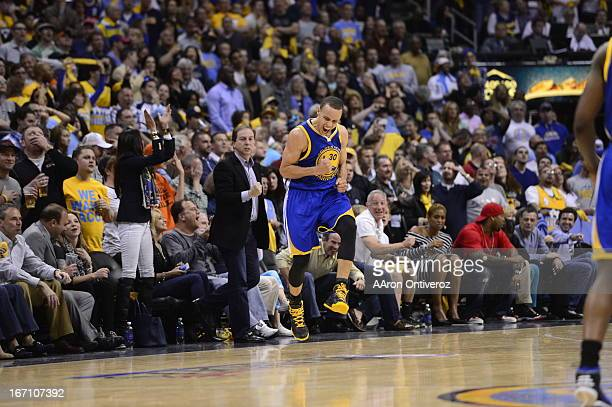 Golden State Warriors point guard Stephen Curry celebrates after hitting a three point shot in the final minute to tie the game in the fourth quarter...