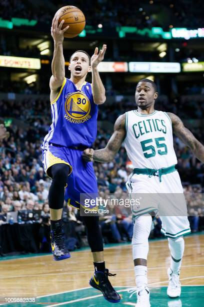 Golden State Warriors point guard Stephen Curry goes for the layup past Boston Celtics shooting guard Terrence Williams during the Boston Celtics...