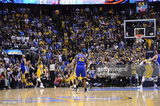 Golden State Warriors point guard Stephen Curry hits a three point shot in the final minute to tie the game in the fourth quarter The Denver Nuggets...