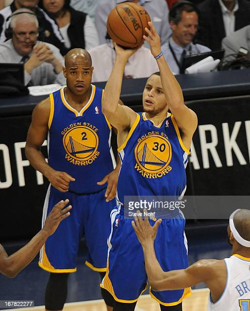 Golden State Warriors point guard Stephen Curry hits a three pointer in the fourth quarter as Jarret Jack looks on The Denver Nuggets took on the...
