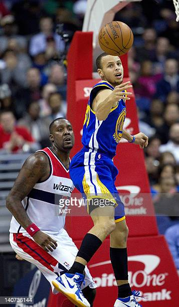Golden State Warriors point guard Stephen Curry looses the ball on his way to the basket in front of Washington Wizards power forward Andray Blatche...