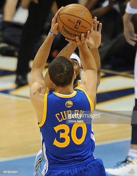 Golden State Warriors point guard Stephen Curry shoots a jump shot over Corey Brewer of Denver The Denver Nuggets took on the Golden State Warriors...