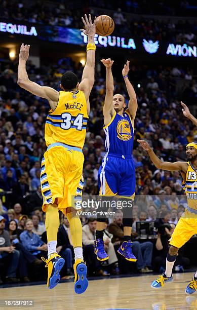 Golden State Warriors point guard Stephen Curry takes a shot over Denver Nuggets center JaVale McGee in the second quarter The Denver Nuggets took on...