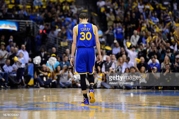 Golden State Warriors point guard Stephen Curry walks down the court in the second quarter The Denver Nuggets took on the Golden State Warriors in...