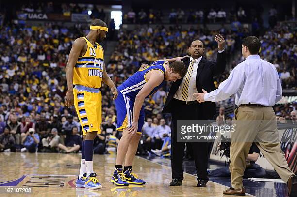 Golden State Warriors power forward David Lee leaves the court after getting hurt The Denver Nuggets took on the Golden State Warriors in Game 1 of...