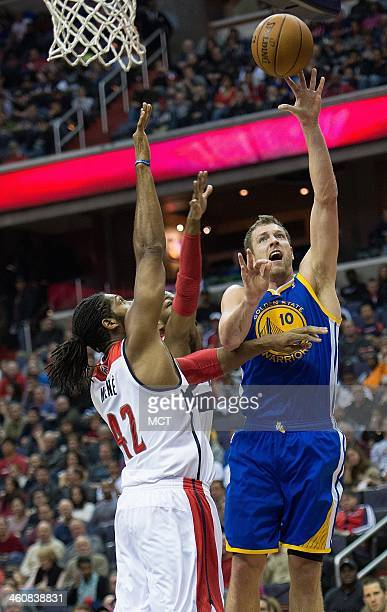 Golden State Warriors power forward David Lee shoots over Washington Wizards power forward Nene Hilario during the first half of their game played at...