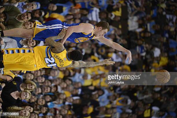 Golden State Warriors power forward David Lee takes a shot over Denver Nuggets shooting guard Wilson Chandler in the second quarter The Denver...