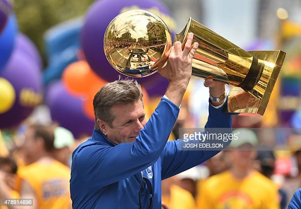 Golden State Warriors President and COO Rick Welts holds up the NBA championship trophy during the annual Gay Pride Parade in San Francisco,...