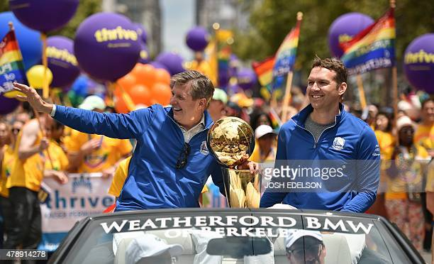 Golden State Warriors President and COO Rick Welts waves to the crowd while holding the NBA championship trophy during the annual Gay Pride Parade in...