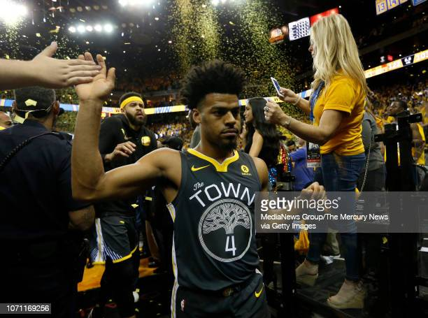 Golden State Warriors' Quinn Cook is greeted by fans on the way to the locker room after beating the Cleveland Cavaliers 122103 in Game 2 of the NBA...