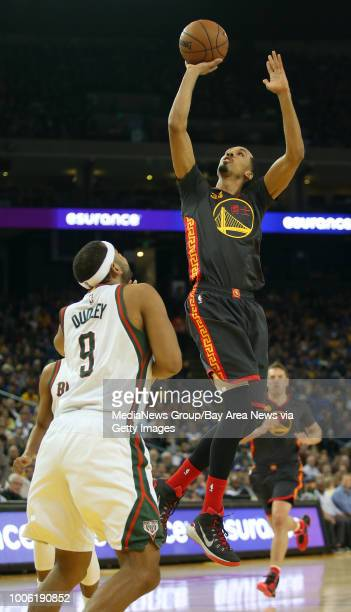Golden State Warriors' Shaun Livingston shoots over Milwaukee Bucks' Jared Dudley during the second quarter of their NBA basketball game at Oracle...