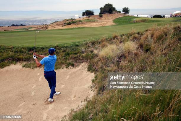 Golden State Warriors star Stephen Curry hits out of the fairway bunker on the ninth hole during the first round of the Ellie Mae Classic golf...