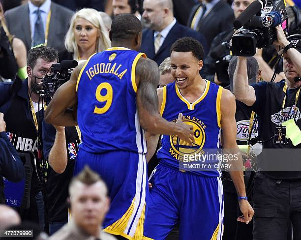 Golden State Warriors Stephen Curry and MVP Andre Iguodala celebrate after their team defeated the Cleveland Cavaliers in Game 6 to win the 2015 NBA...
