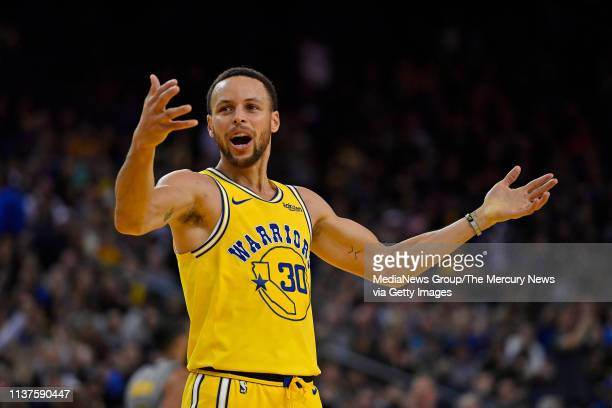 Golden State Warriors' Stephen Curry attempts to encourage the crowd while playing the Indiana Pacers during the third quarter of their NBA game at...