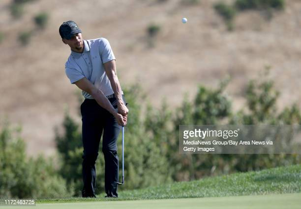 Golden State Warriors' Stephen Curry chips onto the 10th green during a practice round at the Web.com Tour Ellie Mae Classic at TPC Stonebrae in...