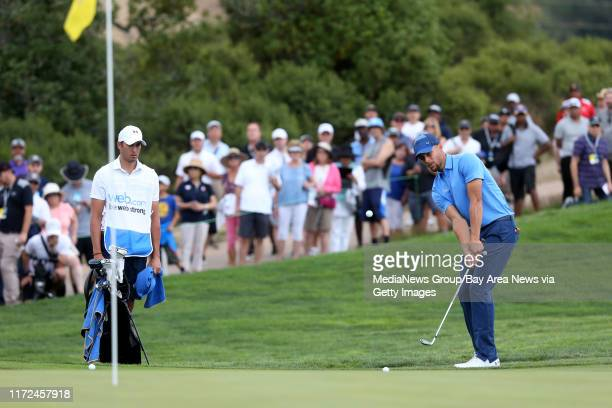Golden State Warriors' Stephen Curry chips onto the 11th green in the first round of the Web.com Tour Ellie Mae Classic at TPC Stonebrae in Hayward,...