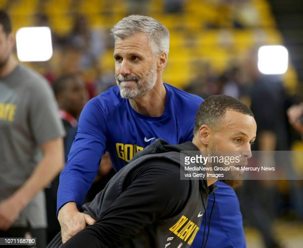 Golden State Warriors' Stephen Curry does a drill with assistant coach Bruce Fraser during warmups before Game 2 of the NBA Finals against the...