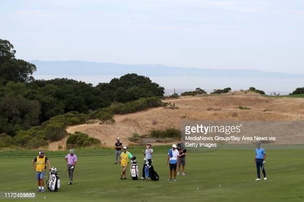 Golden State Warriors' Stephen Curry, far right, and his group on the 15th fairway in the first round of the Web.com Tour Ellie Mae Classic at TPC...