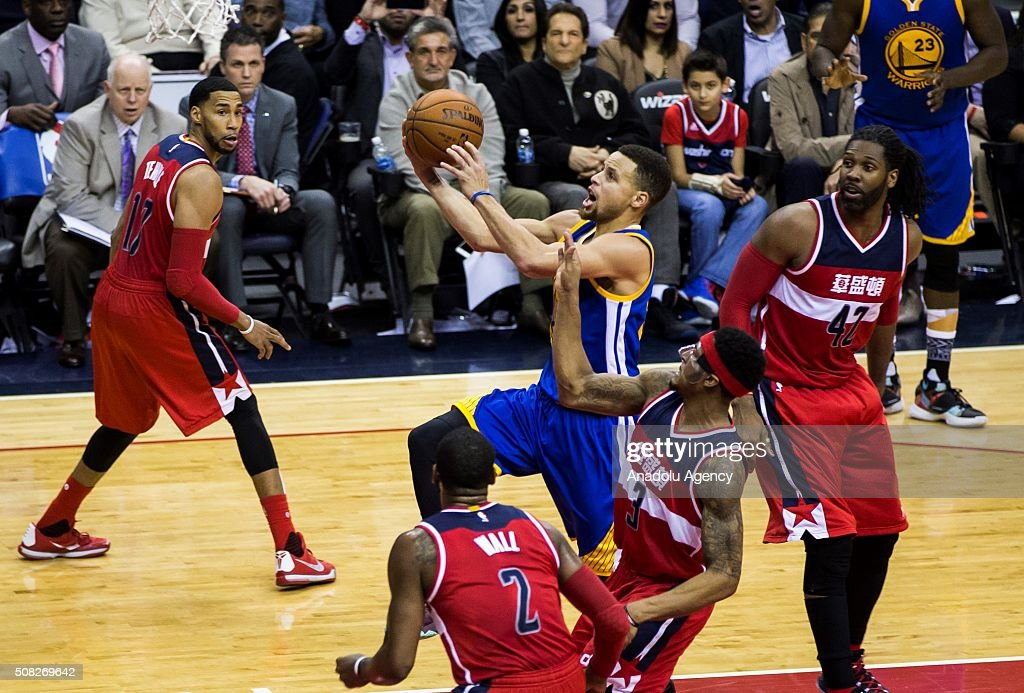 Golden State Warriors Stephen Curry (30) goes up for a shot through multiple Washington Wizard players at the Verizon Center in Washington, USA on February 3, 2016. Curry scored a total of 51 points in Golden States 134-121 win over Washington.
