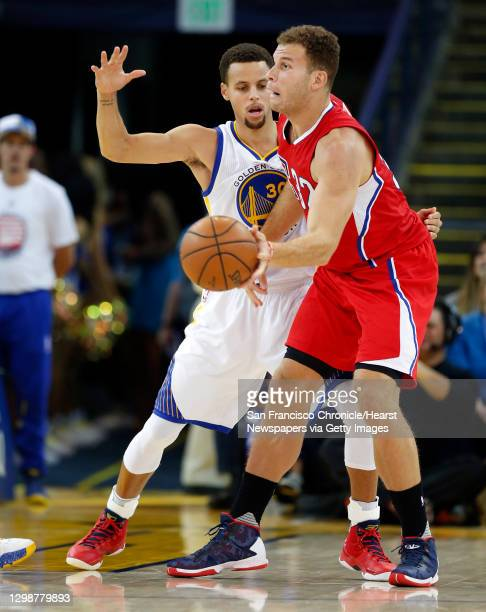 Golden State Warriors' Stephen Curry guards Los Angeles Clippers' Blake Griffin in 2nd quarter during NBA game at Oracle Arena in Oakland, Calif., on...
