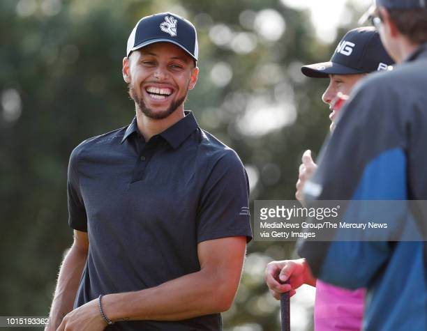 Golden State Warriors Stephen Curry jokes with Taylor Moore on the 13th teebox during their practice round for the Ellie Mae Classic golf tournament...