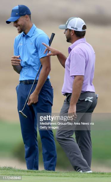 Golden State Warriors' Stephen Curry, left, and Stephan Jaeger joke around on the 16th green during the first round of the Web.com Tour Ellie Mae...