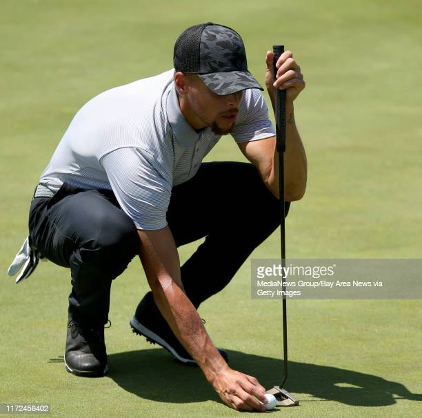 Golden State Warriors' Stephen Curry lines up a putt on 16th green during a practice round at the Web.com Tour Ellie Mae Classic at TPC Stonebrae in...