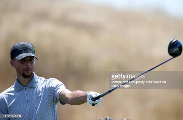 Golden State Warriors' Stephen Curry lines up his tee shot on the 17 hole during a practice round at the Web.com Tour Ellie Mae Classic at TPC...