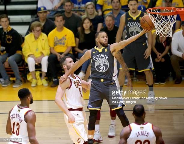 Golden State Warriors' Stephen Curry makes a layup against the Cleveland Cavaliers during the first quarter of Game 2 of the NBA Finals against the...