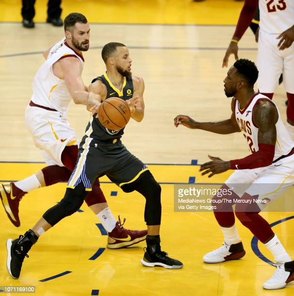 Golden State Warriors' Stephen Curry passes as he's guarded by Cleveland Cavaliers' Jeff Green during the first quarter of Game 2 of the NBA Finals...