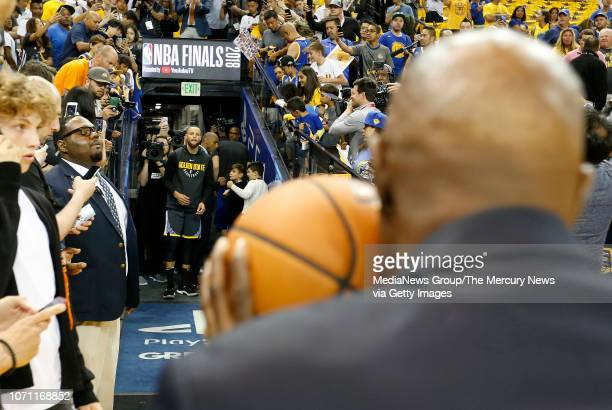 Golden State Warriors' Stephen Curry prepares to take his traditional long shot during warmups before Game 2 of the NBA Finals against the Cleveland...
