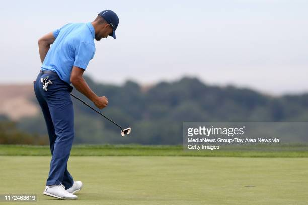 Golden State Warriors' Stephen Curry pumps his fist after making a par putt on the 18th green in the first round of the Web.com Tour Ellie Mae...