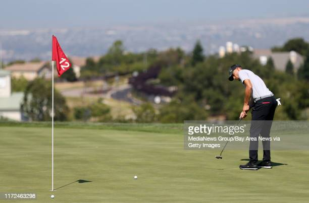 Golden State Warriors' Stephen Curry putts on the 12th green during a practice round at the Web.com Tour Ellie Mae Classic at TPC Stonebrae in...