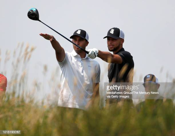 Golden State Warriors Stephen Curry right looks at his teeshot on the third hole with his caddy Warriors Jonnie West during his practice round for...
