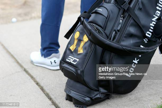 Golden State Warriors' Stephen Curry stands next to his golf bag during the first round of the Web.com Tour Ellie Mae Classic at TPC Stonebrae in...