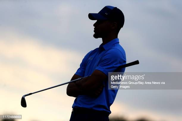 Golden State Warriors' Stephen Curry stands on the 10th hole fairway in the first round of the Web.com Tour Ellie Mae Classic at TPC Stonebrae in...