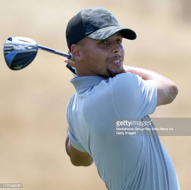 Golden State Warriors' Stephen Curry tees off on the 17 hole during a practice round at the Web.com Tour Ellie Mae Classic at TPC Stonebrae in...