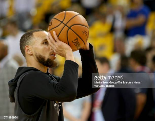 Golden State Warriors' Stephen Curry warms up before Game 2 of the NBA Finals against the Cleveland Cavaliers at Oracle Arena in Oakland Calif on...