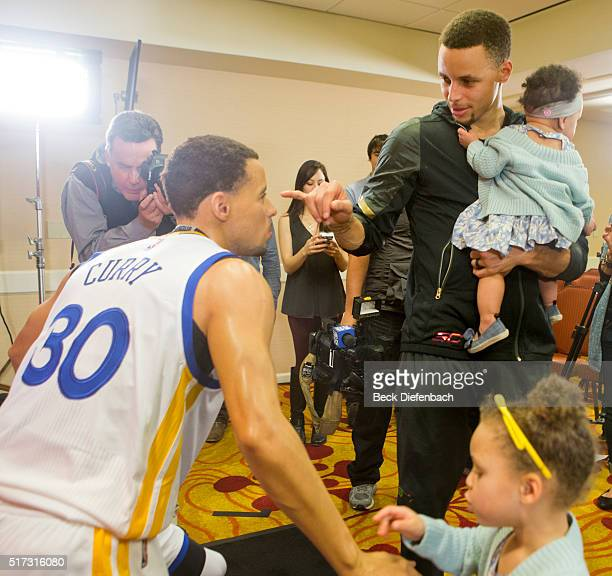 Golden State Warriors' Stephen Curry with his daughters Riley and Ryan inspects his wax figure made by Madame Tussauds San Francisco located on...