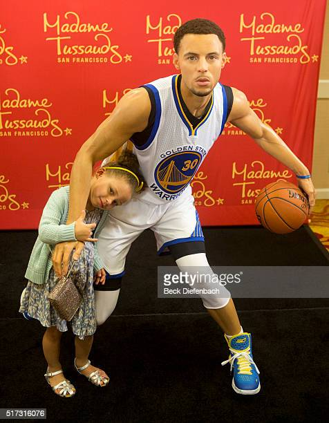 Golden State Warriors' Stephen Curry's daughter Riley poses with her father's wax figure made by Madame Tussauds San Francisco located on Fisherman's...