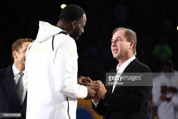 Golden State Warriors team owner Joe Lacob gives Draymond Green his 20172018 Championship ring prior to their game against the Oklahoma City Thunder...